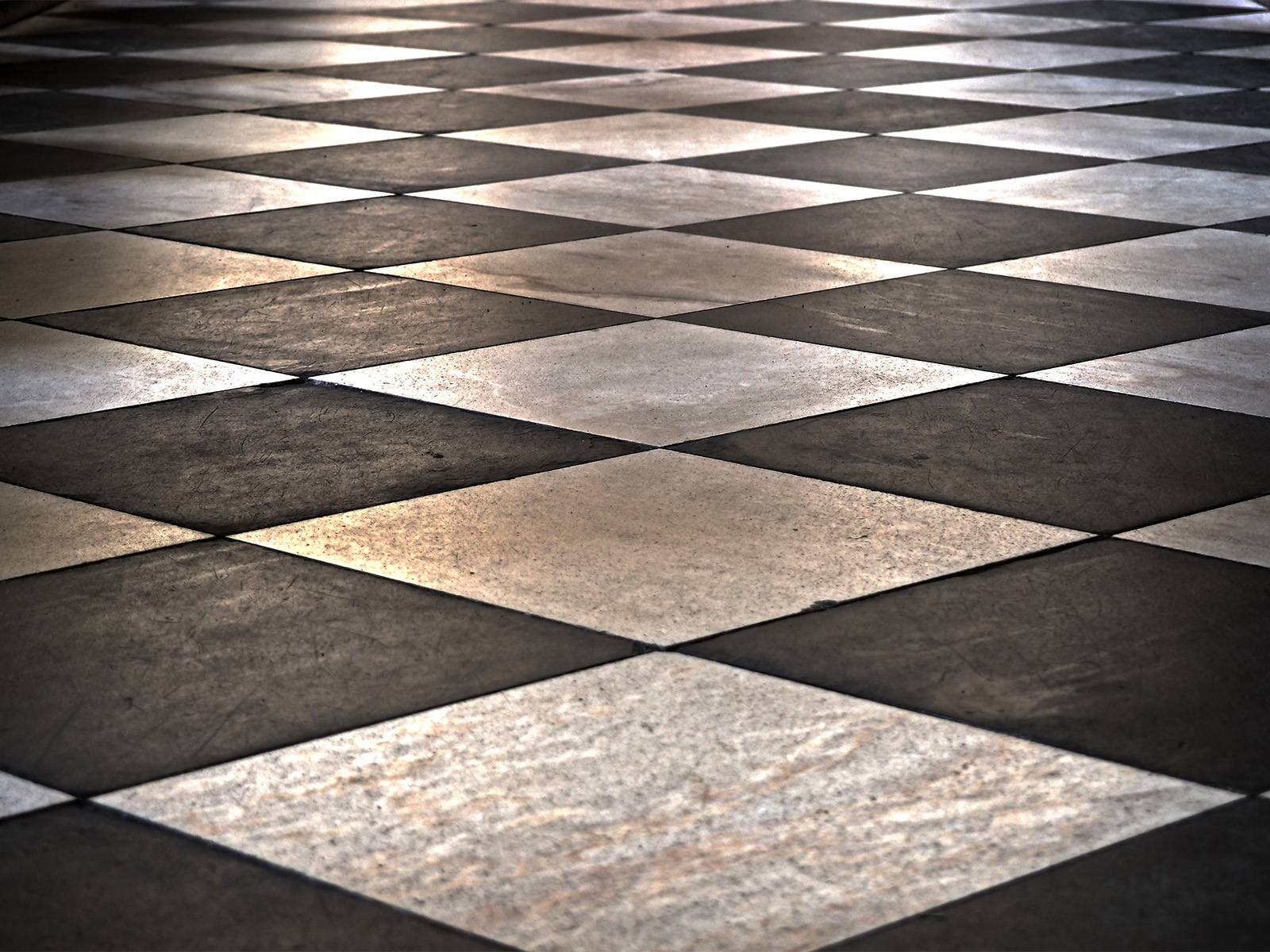 Wall and floor tiling services in London, grouting and re-grouting, surface preparation, ditra matting, tile trims, repair work, grout colours, silicone sealant, marble installs, porcelain and ceramic tiling, external tiling, mosaic tiling